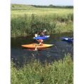 Kayaking down the river.