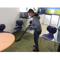 Learning to use a hoover.