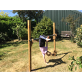 Ruby practising her gymnastics at home