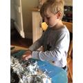 Joel making his model