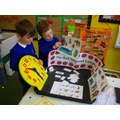 Using a story sack to retell familiar stories.