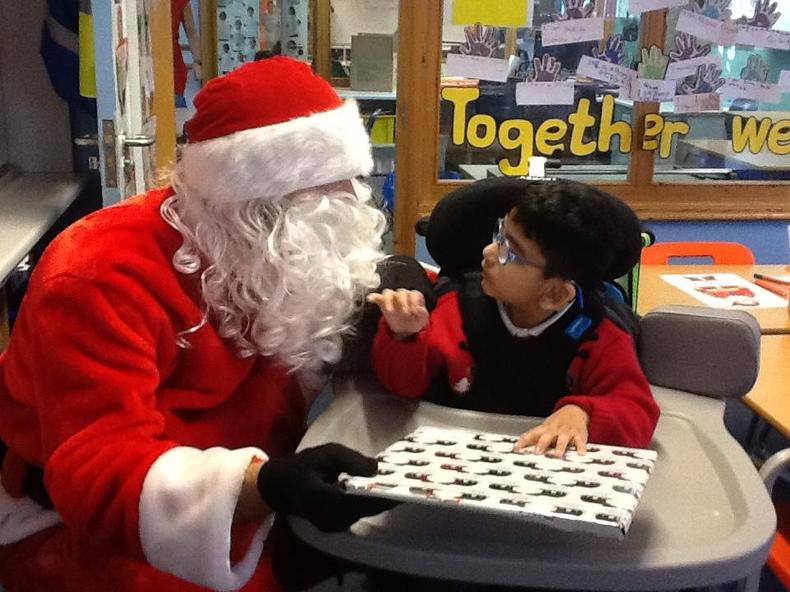 Receiving his present from Santa