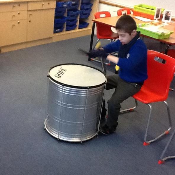 Drumming away on the samba drum.