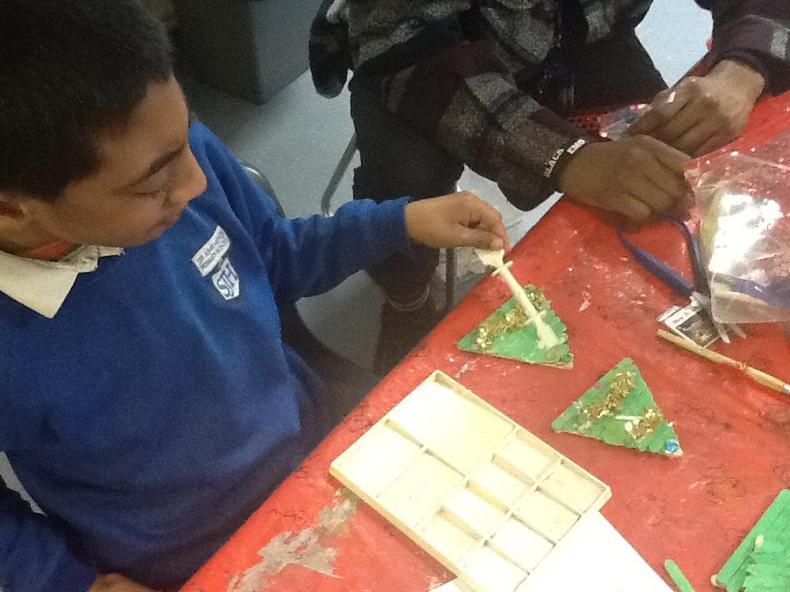 Decorating his Christmas tree