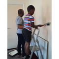 Jamil helping decorate his home