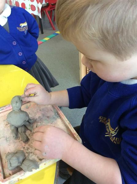 Creating a dragon using clay