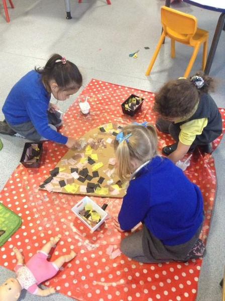 Working together to decorate a loving heart.