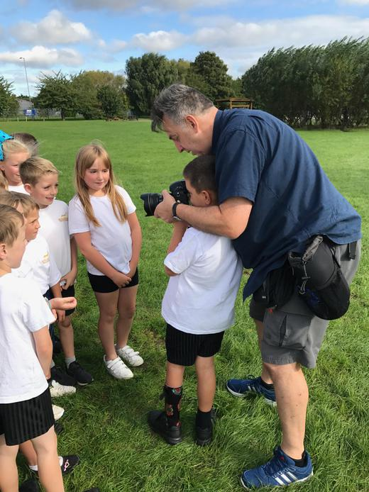 Mr Weekes taking photos of our Year 4s