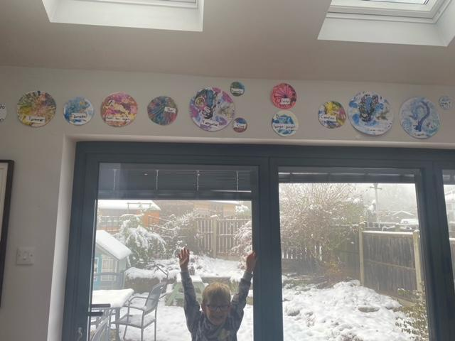 Leo's amazing solar system art work in his house - this looks fab!