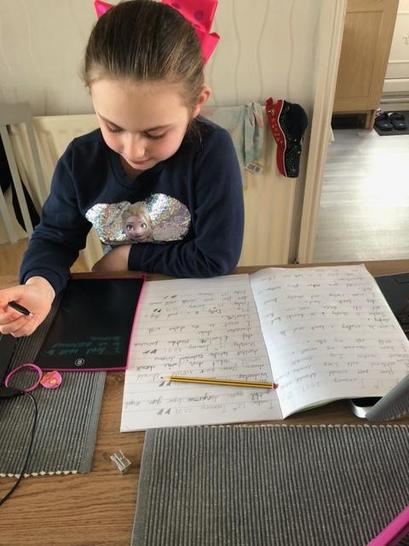 Eleanor concentrating on her home learning