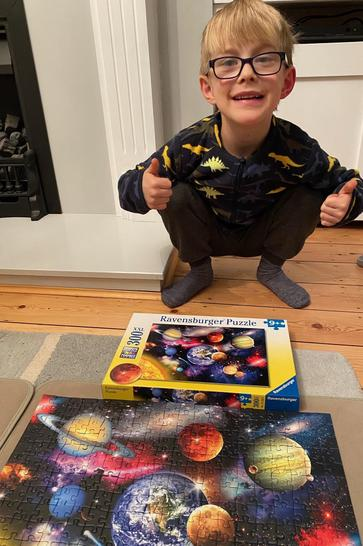 Leo feeling very proud of his 300 piece planets puzzle!