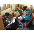 Enjoying and exploring our reading corner