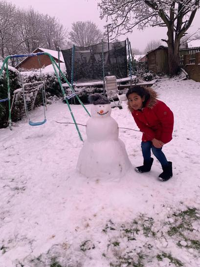 Alina enjoying playing in the snow - what a huge snowman!