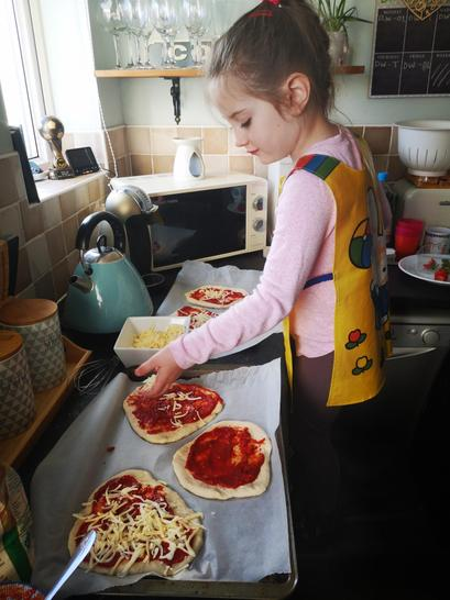 Penelope making her families tea! Pizza, yum!