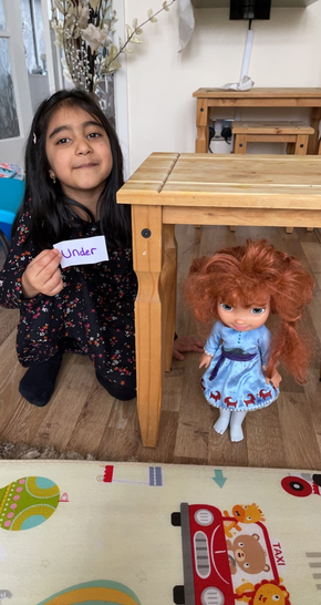 Zoya used her doll to help her with her positional language.