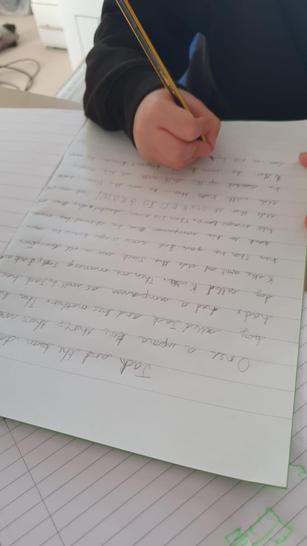 Here is Finlay writing a story.