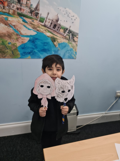 Hasnain has made some masks for Little Red Riding Hood.