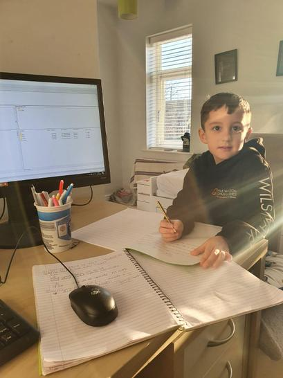 Here is Finlay ready to do his home learning in his office.