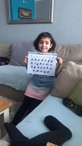 Anayah practising her lovely cursive handwriting