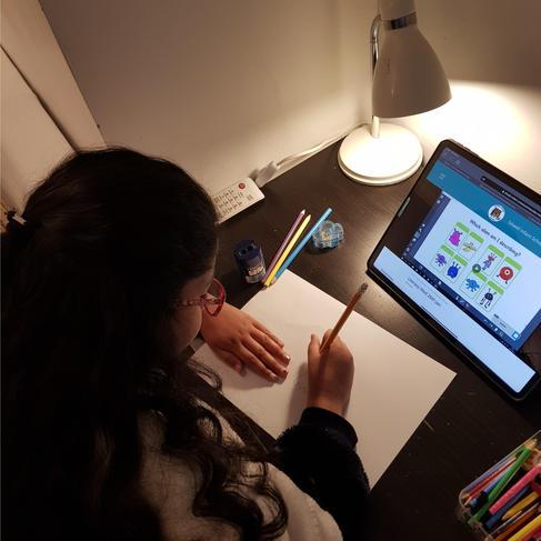 Alina working hard on her literacy this week.
