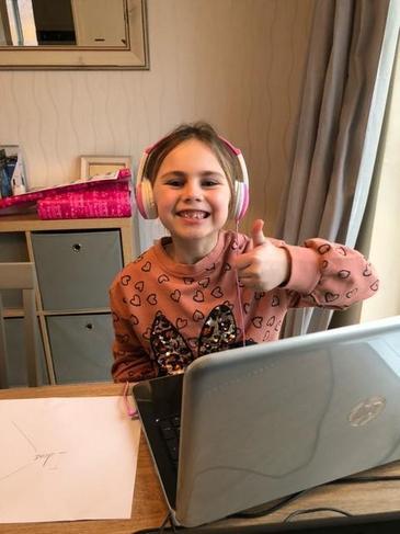 Eleanor enjoying her home learning