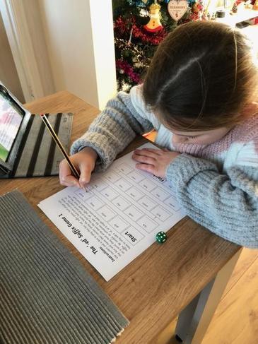 Eleanor practising her suffixes