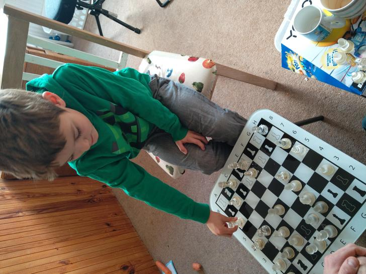 Practising his problem solving with a game of chess