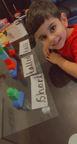 Harris has been working hard on his maths work.