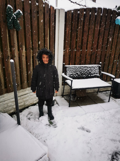 Kyann also went out in the snow.