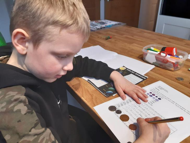 Jack working hard on his maths