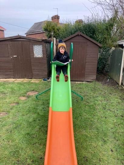 Jack completing Mrs Peart's Reading challenge!