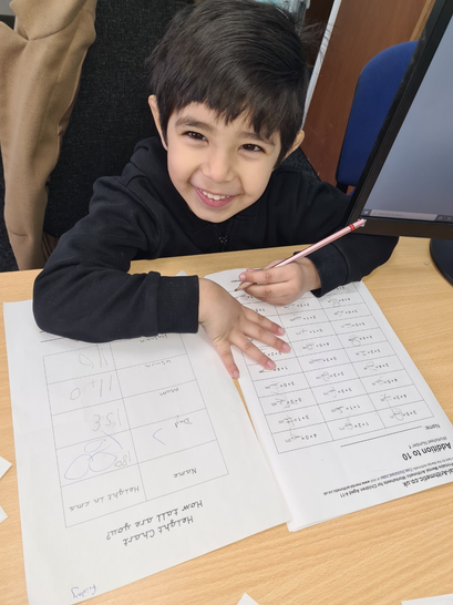 Hasnain has worked hard on his maths this week.