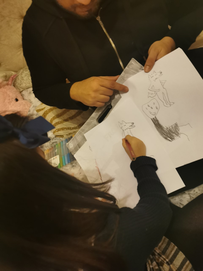 Hana-Mariam and Dad working on her sketch.