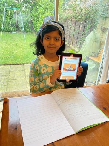 Zaina working hard on her home learning