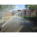 The water made a rainbow in the sunshine!