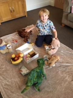 Reuben and his teddies enjoying their picnic.