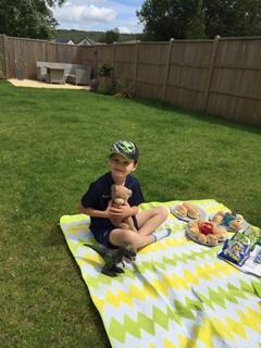 Lewis enjoying his picnic with his teddies!