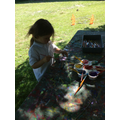 On Monday we decided to paint sticks with sparkly paint,