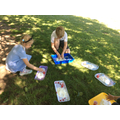 We played with cornflour and water in the shade of the trees on Monday.