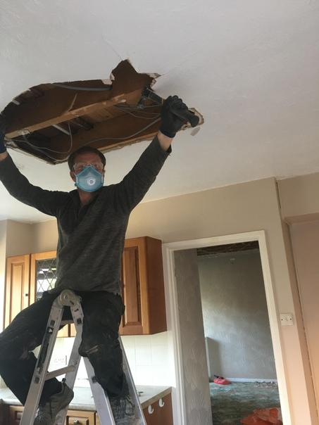 James taking down the kitchen ceiling