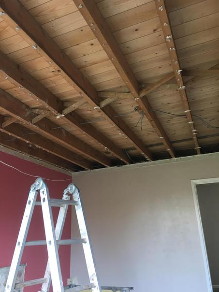 The living room ceiling had to come down so we could replace the electrics