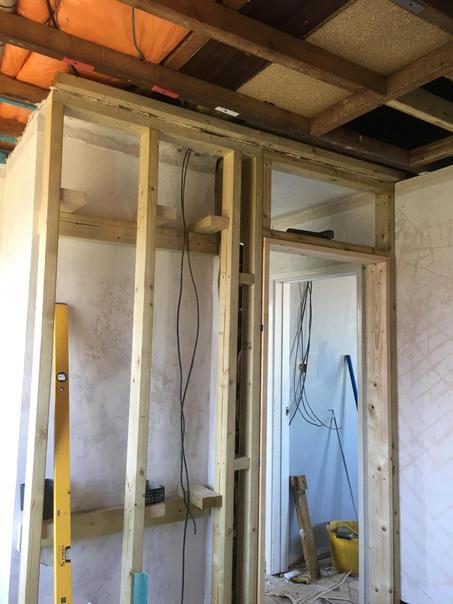 Putting the new door frame in the bathroom