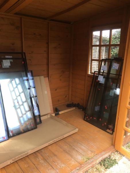 They didn't all fit in the garage, so some of the glass is in the summer house instead!