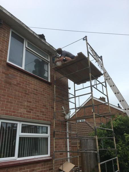 We've finally started to take the old guttering off the front of the house