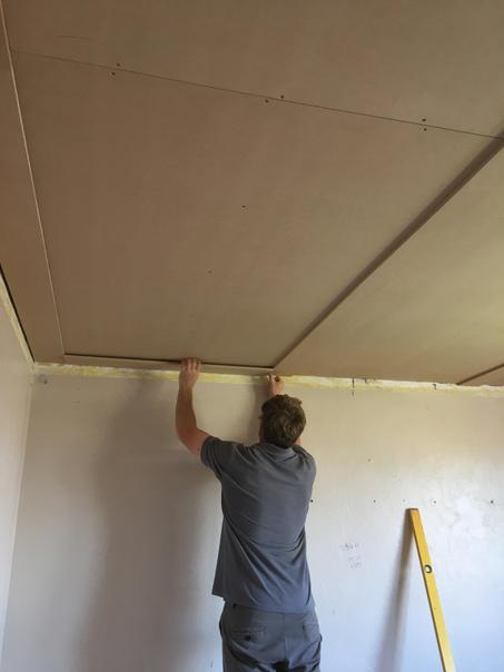 Fitting the panelling in the bedroom