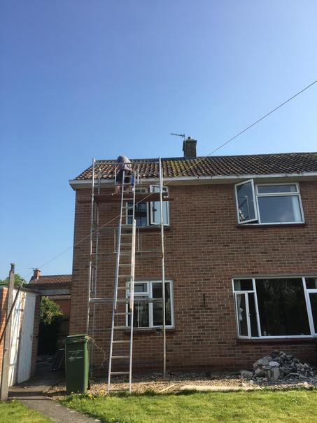 Removing the old gutters from the back of the house