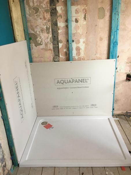 Fitting the new shower tray