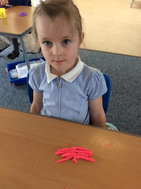 RAN-Lexi C - made a fantastic butterfly using playdough..JPG
