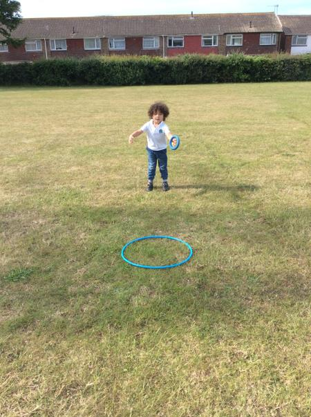 RAN - Loki NT - throwing a quoit unto a hoop during PE.JPG