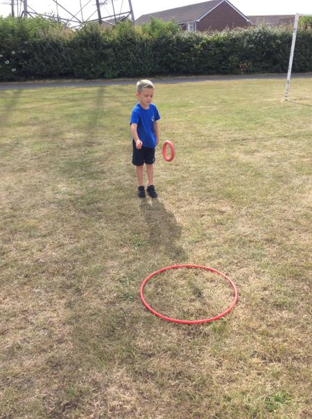 RAN - Jay K - throwing a quoit into a hoop during PE.JPG